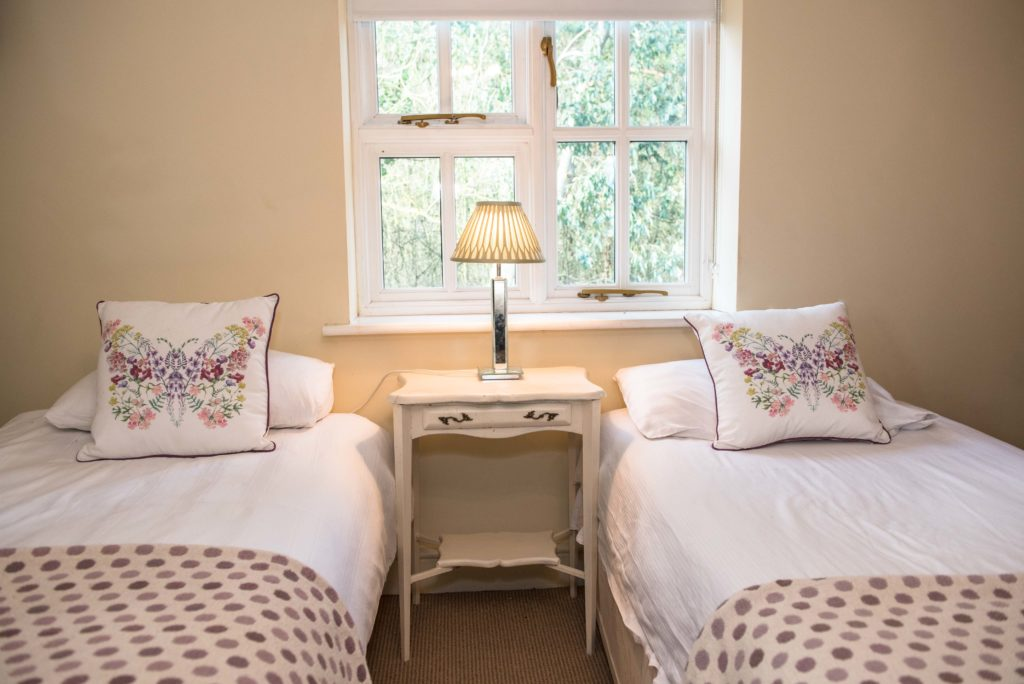 Bedroom 2 with two single beds and 1 double ensuite is situated in this room