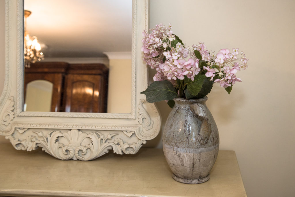 Large mirror in bedroom 2 with vase